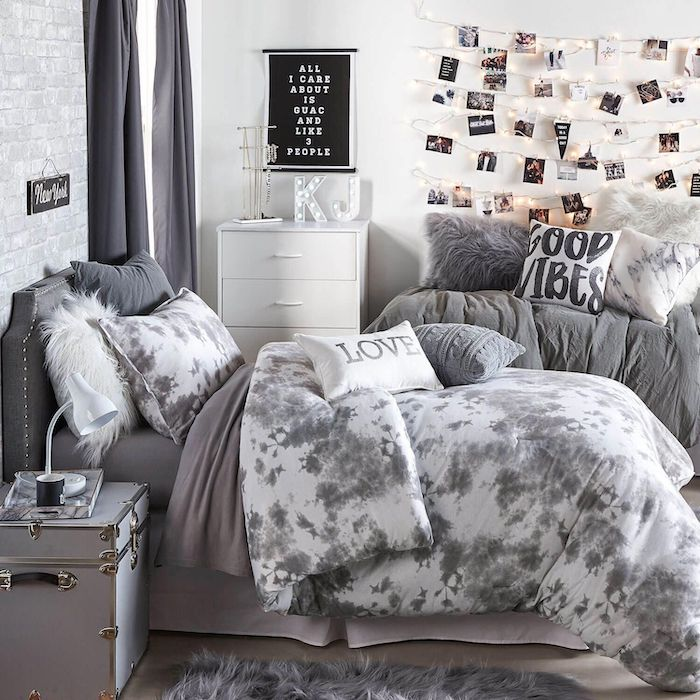 gray bed linen with white and gray throw pillows teen girl room ideas white walls polaroids hanging on the wall with fairy lights