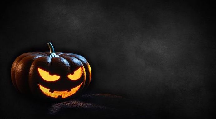 halloween background dark gray background photo of spooky jack o lantern at the forefront