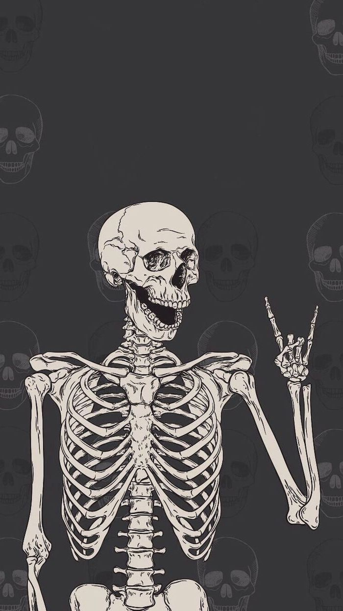 halloween desktop backgrounds dark gray background with skulls skeleton showing the rock sign at the forefront