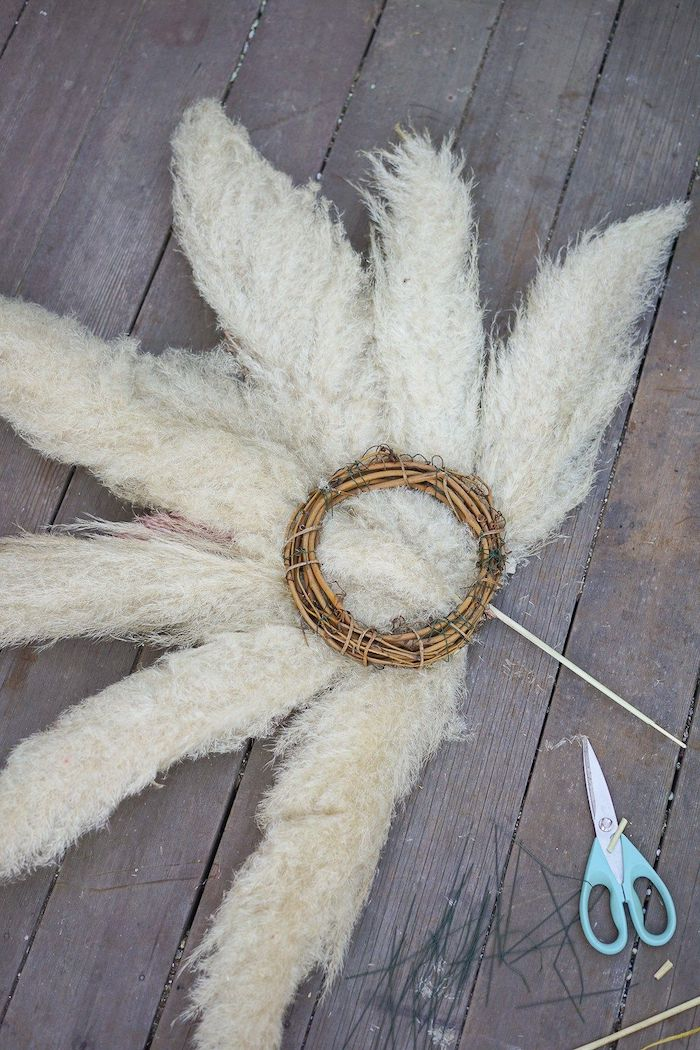 how to dry pampas grass back of the wreath made with white grass placed on wooden surface scissors on the side