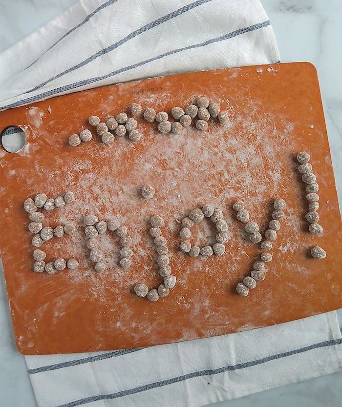 how to make boba tapioca pearls arranged on wooden cutting board spelling the word enjoy with exclamation mark