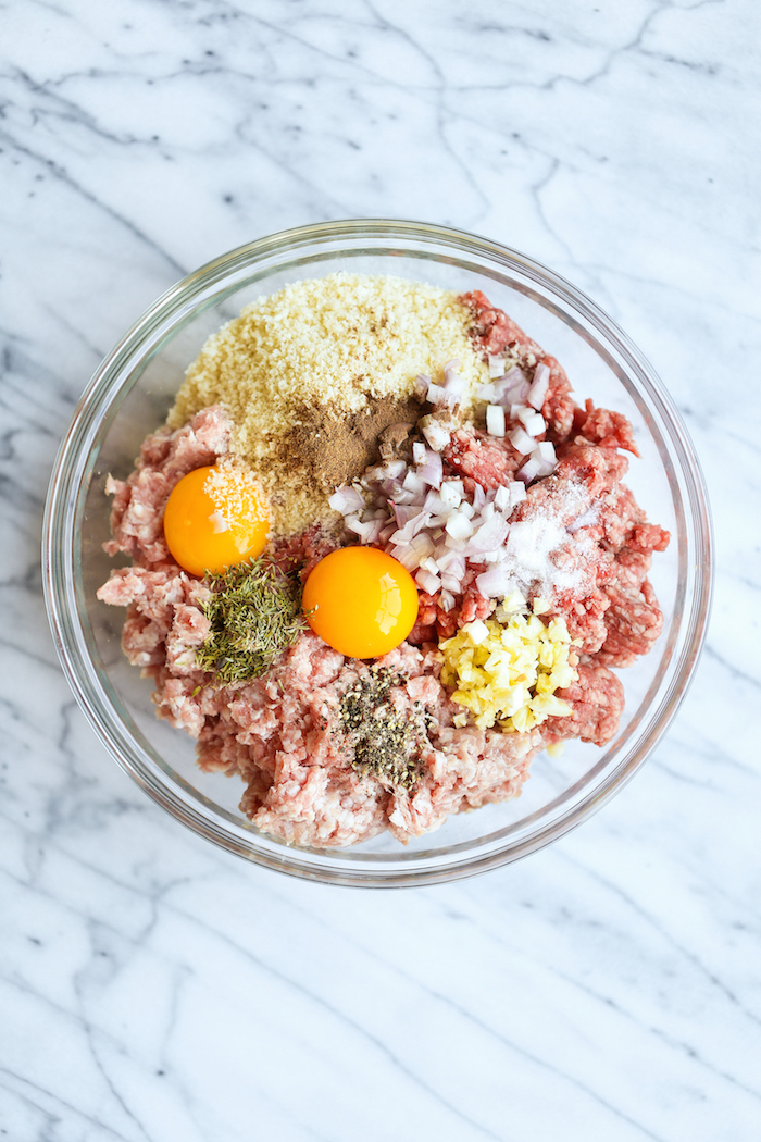 instant pot chicken recipes healthy minced meat herbs onion eggs breadcrumbs inside glass bowl placed on marble surface