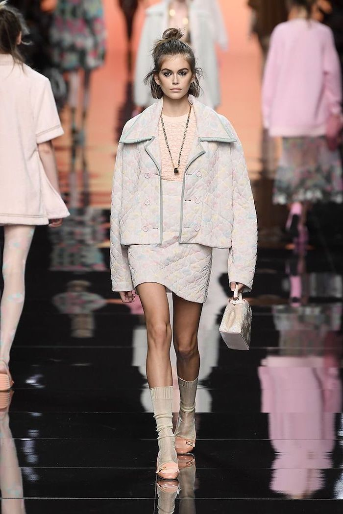 kaia gerber walking on the runway cute outfits for women wearing skirt with oversized jacket carrying small bag