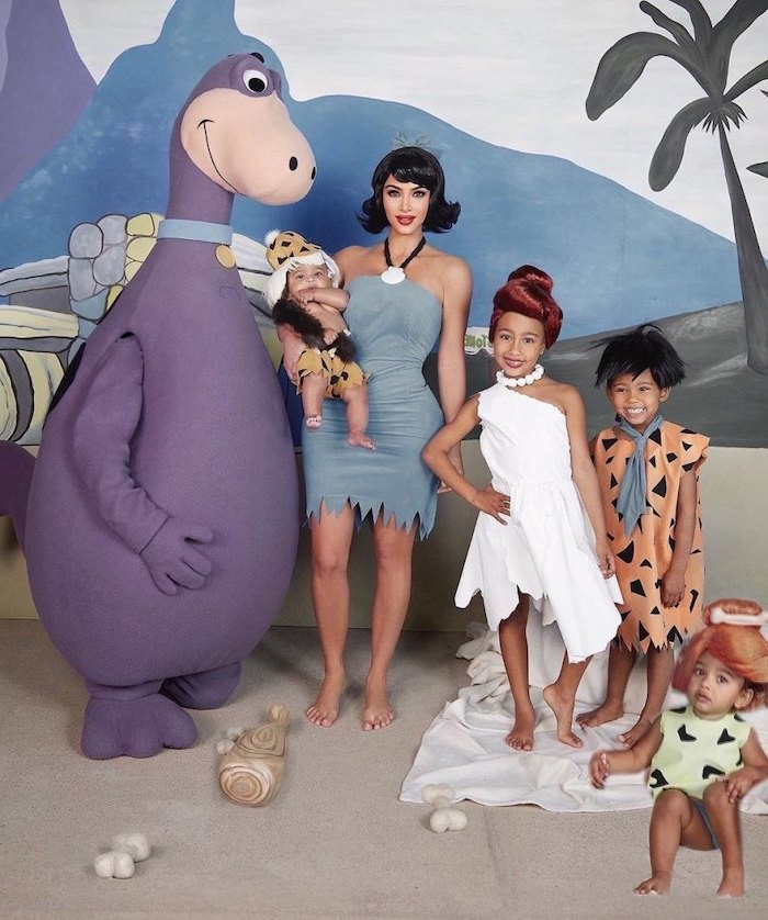 kim kardashian with north saint chicago and psalm dressed as characters from the flintstones family of 4 halloween costumes