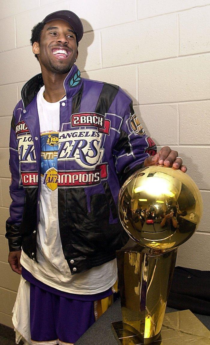 kobe and gigi wallpaper kobe bryant wearing purple leather jacket back 2 back champions standing next to the trophy
