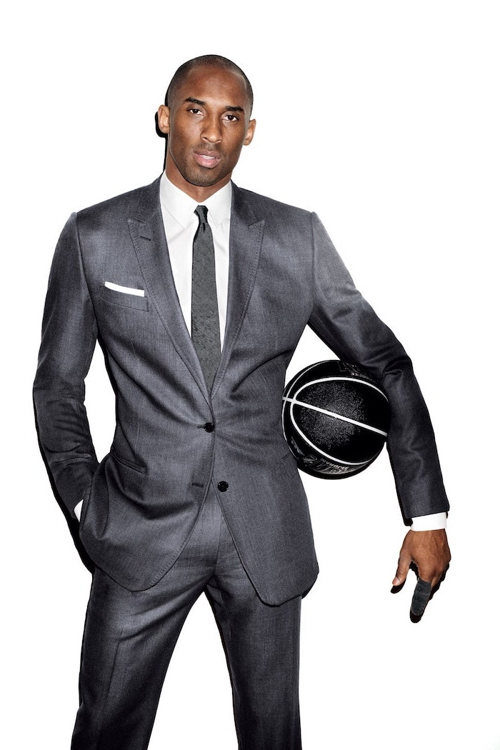 kobe bryant wallpaper hd kobe wearing gray suit white t shirt gray tie holding black basketball on white background
