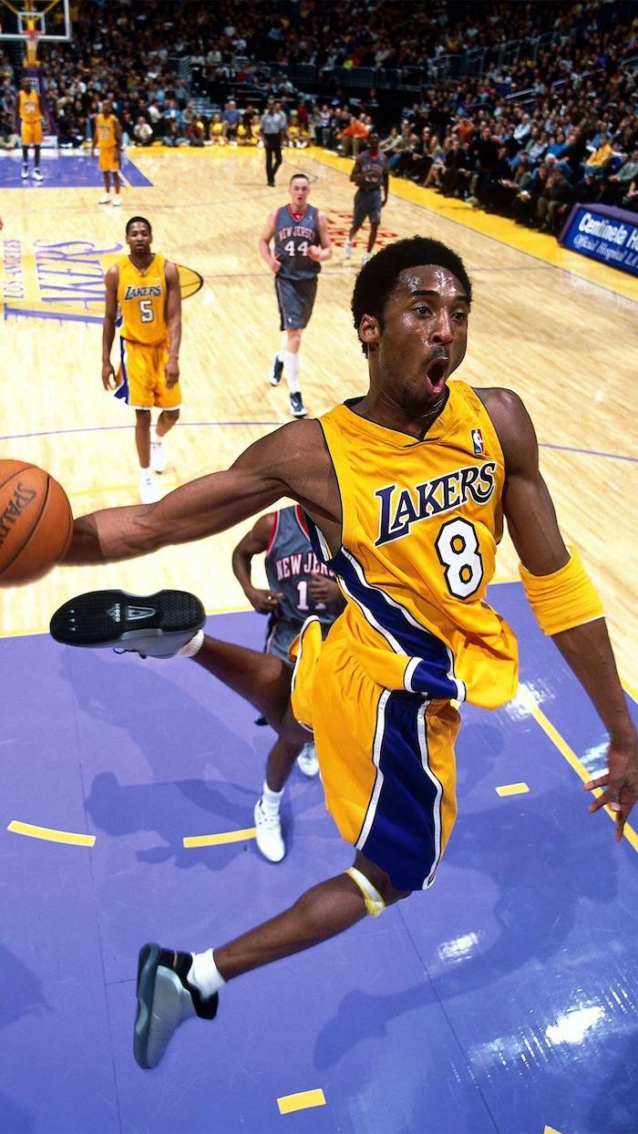 kobe jumping in the air holding a basketball about to dunk it in the basketball hoop iphone kobe bryant wallpaper lakers court