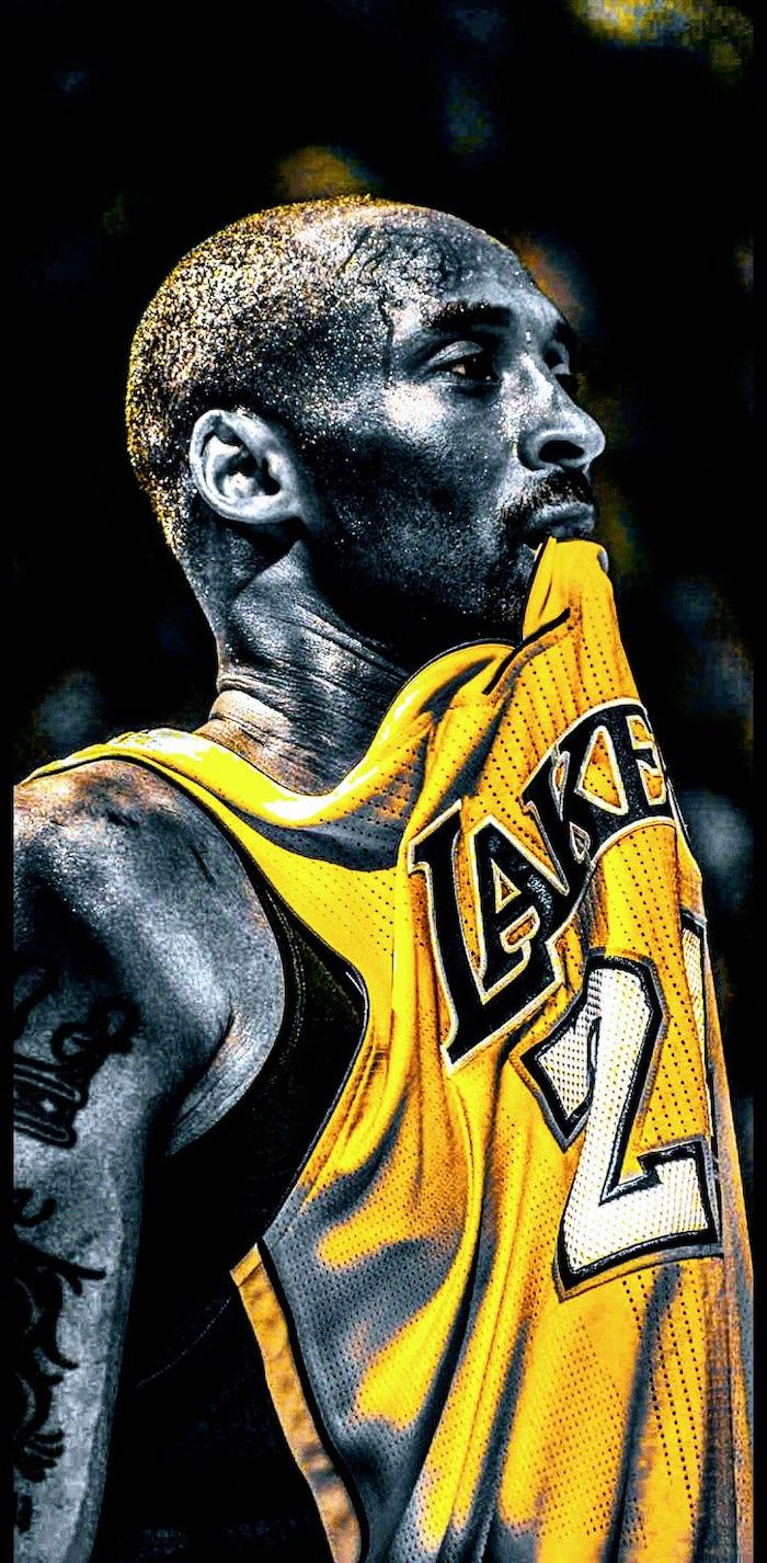 lakers wallpaper black and white photo of kobe wearing yellow lakers jersey biting it sweat dripping down his face