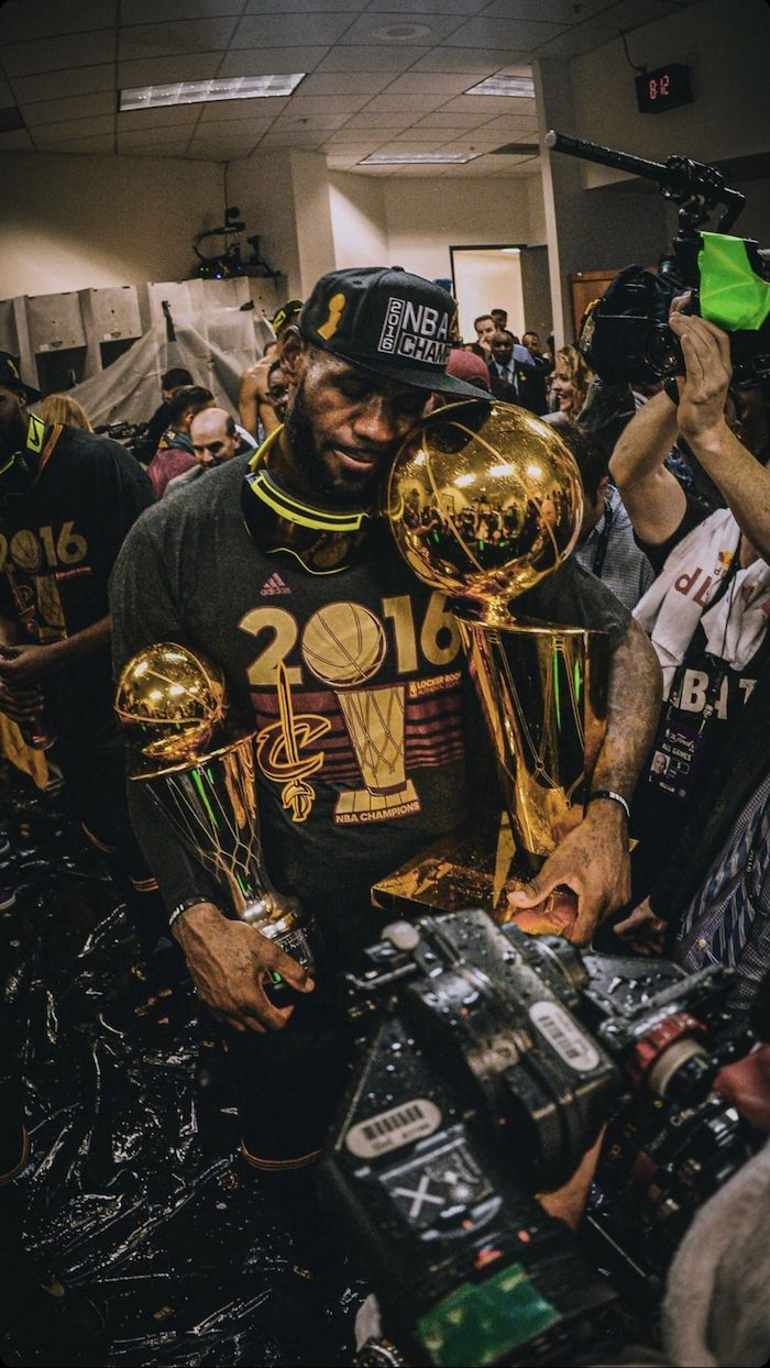 lebron james background in the locker room holding the larry obrient championship trophy finals mvp trophy