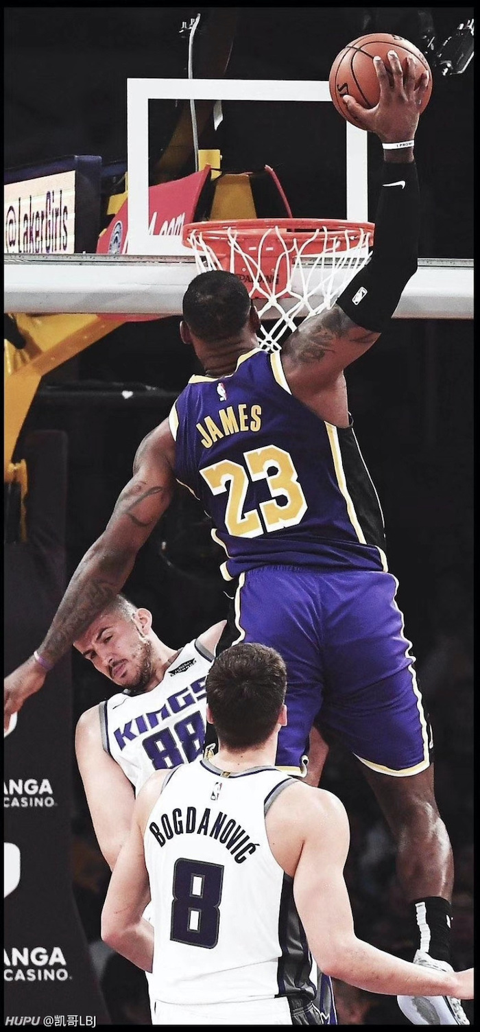lebron james lakers wallpaper wearing lakers uniform jumping in the air about to dunk the ball