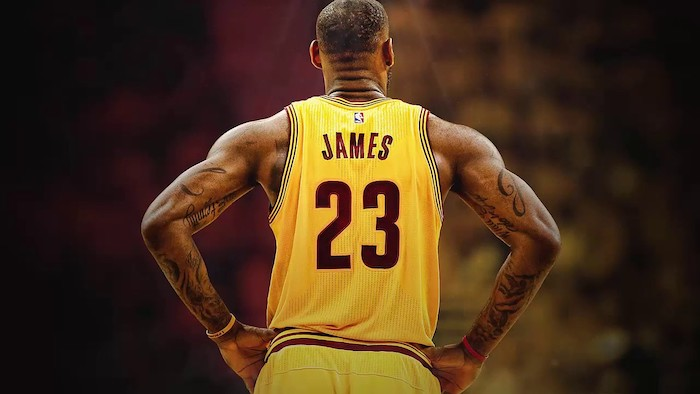 lebron james photographed from the back wearing yellow cleveland cavaliers uniform lebron wallpaper blurred background