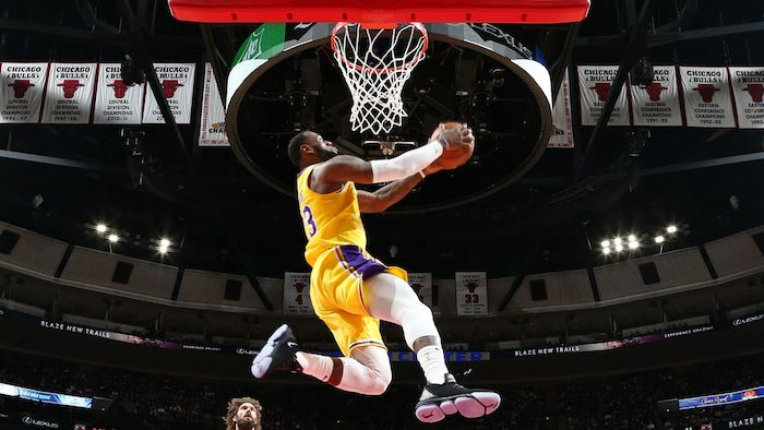 lebron james photographed jumping in the air about to dunk the ball lakers wallpaper wearing lakers uniform