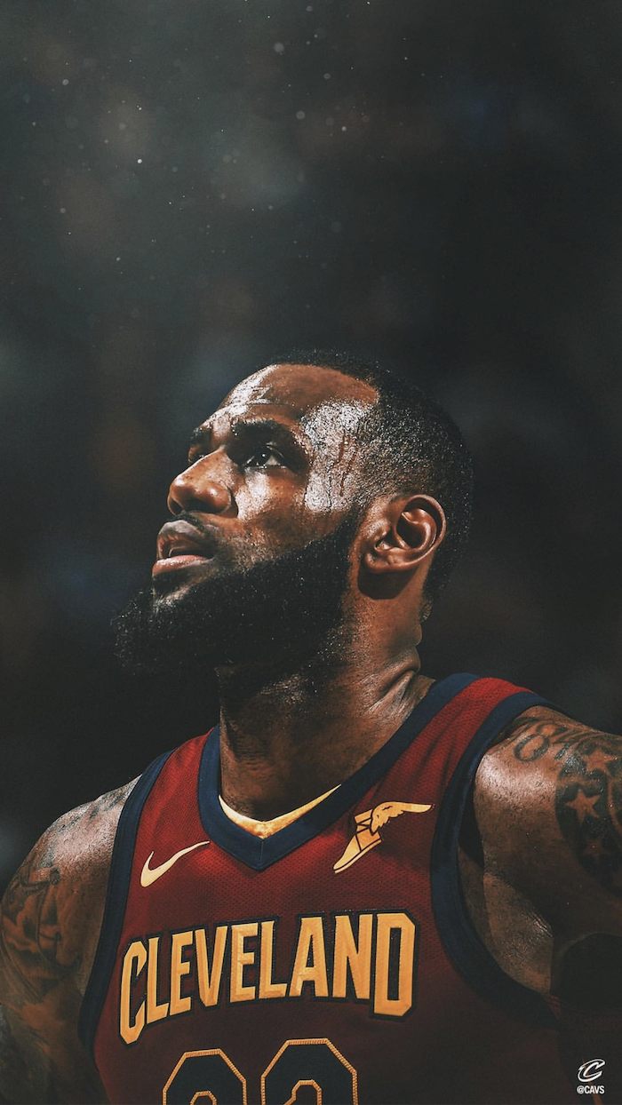 lebron james pictures photo of lebron wearing cleveland cavaliers uniform on the court blurred background