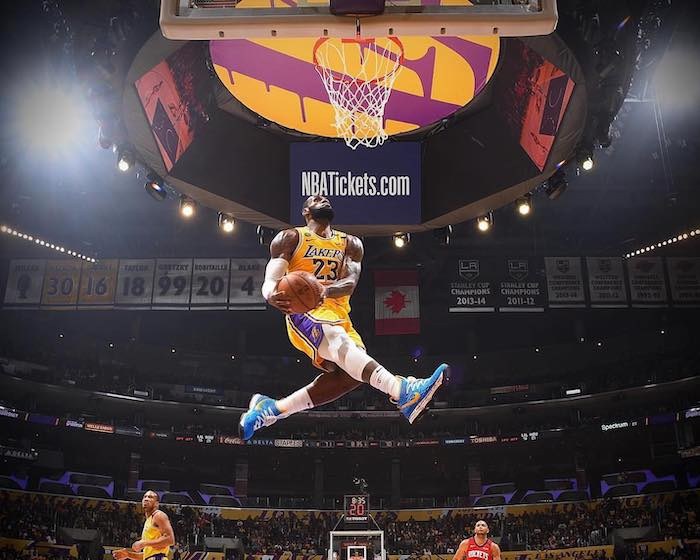 lebron james wallpaper wearing lakers uniform phototgraphed in the air about to dunk the ball