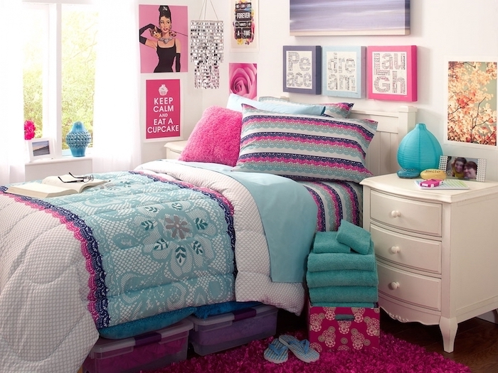 lots of art on the walls around the bed teenage girl bedroom ideas for small rooms colorful pillows pink carpet on wooden floor
