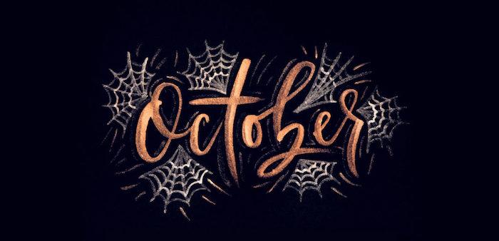 october written in gold cursive font surrounded by webs fall desktop backgrounds black background