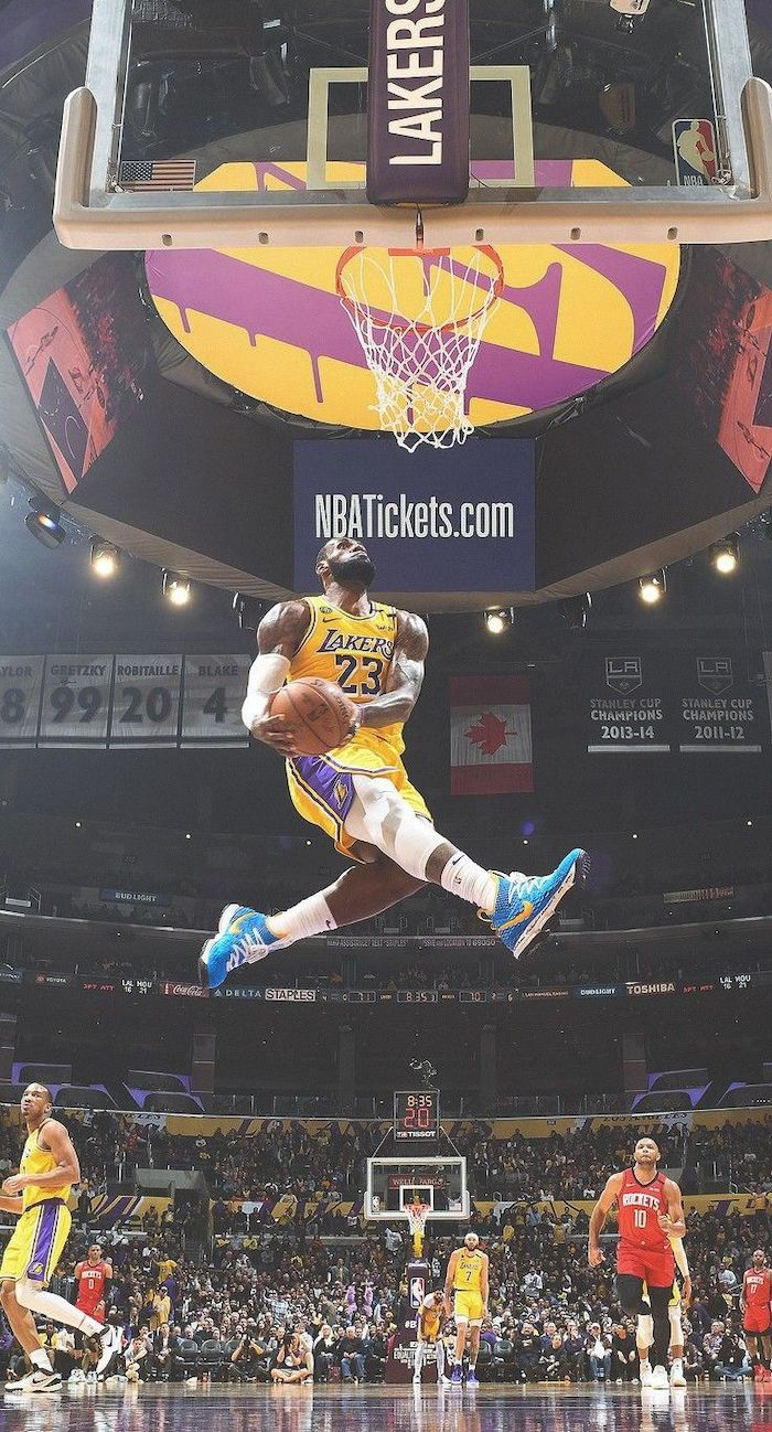 photo of lebron james jumping in the air about to dunk the ball lebron james background