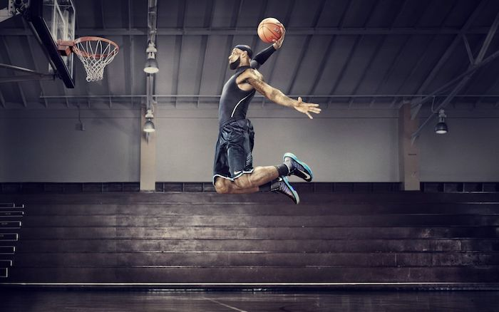 photo of lebron james jumping in the air holding a ball about to dunk it nba wallpaper empty court