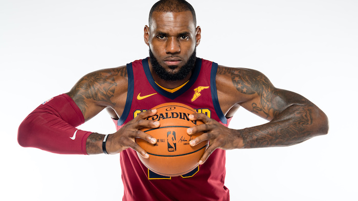 photo of lebron james wearing cleveland cavaliers uniform holding a basketball lebron wallpaper white background