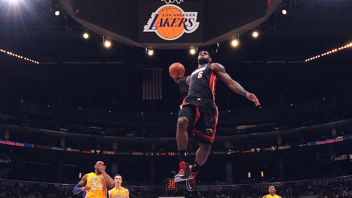 photograph of lebron james jumping in the air wearing miami heat uniform about to dunk the ball lebron wallpaper