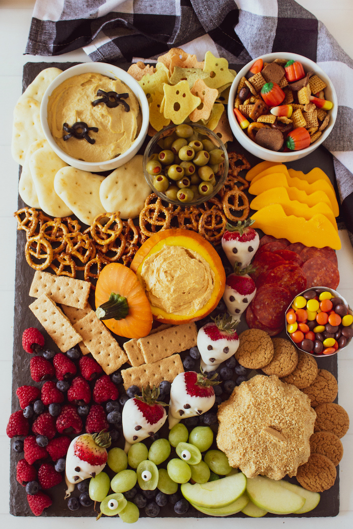 platter full of pretzels crackers dips cheese cookies berries grapes apples halloween snack ideas candy corn mix
