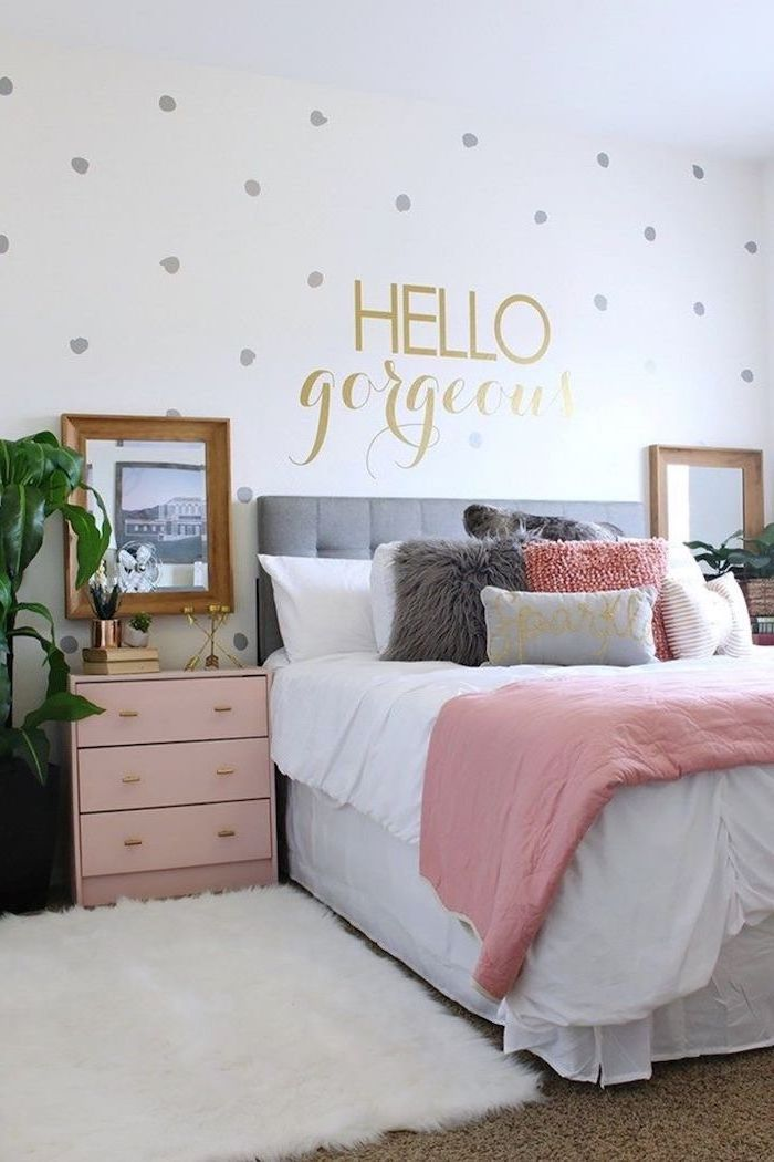 room decor ideas for girls hello gorgeous written with gold letters on white wall with gray dots pink night stand next to the bed with pink white gray throw pillows
