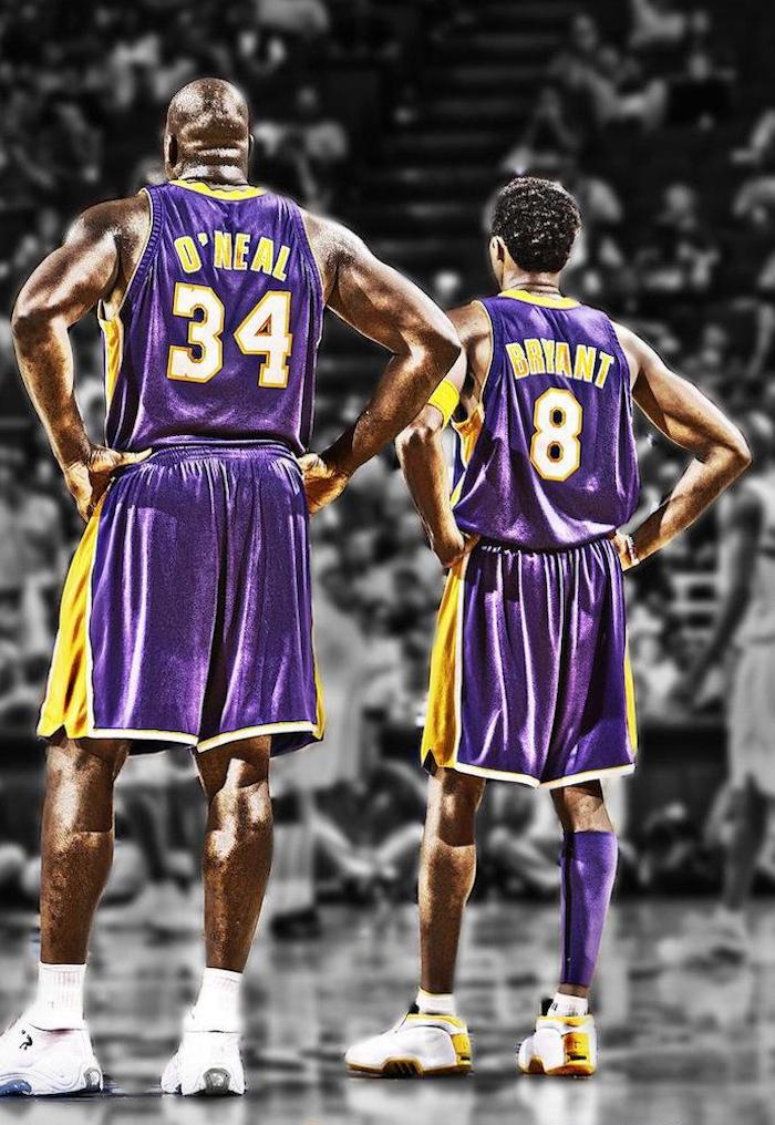 shaquille oneal kobe bryant wearing lakers uniforms standing on the court kobe bryant wallpaper iphone crowd behind them blurred in black and white