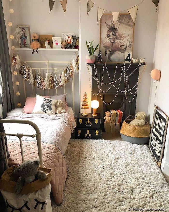 small bed tassel garland hanging above it teen girl room ideas white carpet on wooden floor white walls
