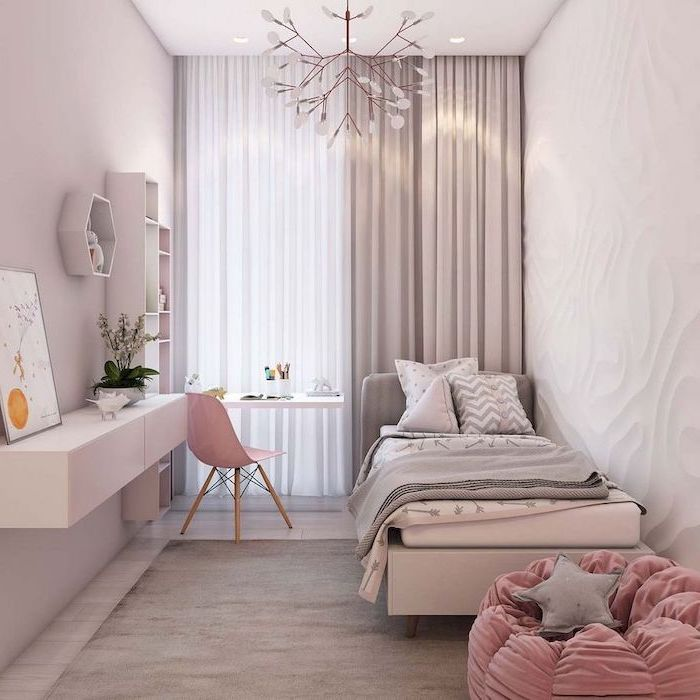 teen girl room ideas wooden floor with gray carpet floating desk with pink chair bookshelf light pink walls pink velvet puff chair