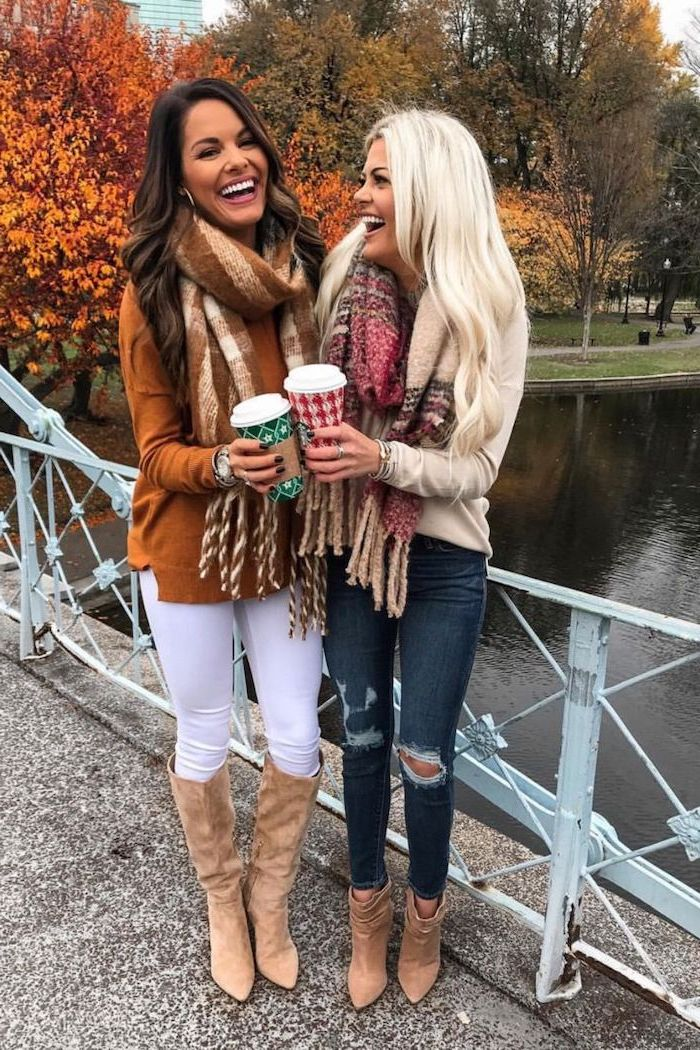 two women standing on a bridge outfit ideas for women wearing jeans and white leggings blouses large scarfs brown velvet boots