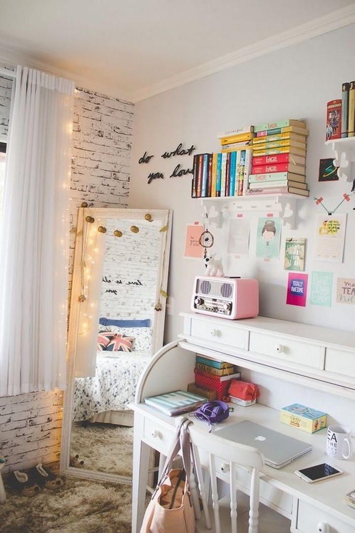white brick wall white desk with bookshelves above it cozy teenage girl room tall mirror with fairy lights around it