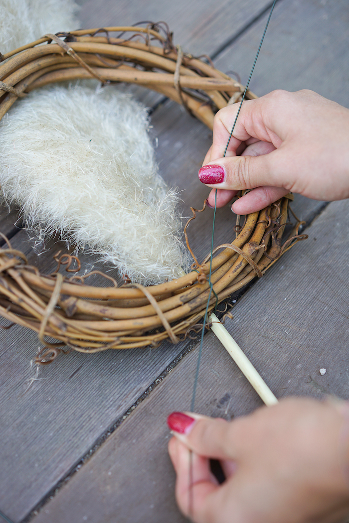 wooden wreath how to dry pampas grass branches being tied to it step by step diy tutorial