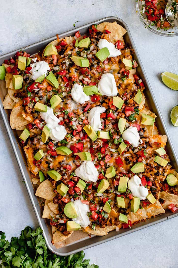 achos baked in sheet pan authentic mexican recipes with corn black beans tomatoes avocado chopped parsley