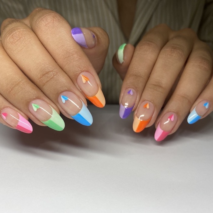 acrylic nail designs long almond nails french manicure in shades of blue orange pink green purple with hearts on the bottom