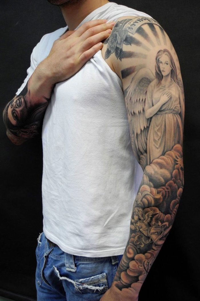 arm sleeve tattoo of female angel above clouds strength symbol tattoo man wearing white t shirt jeans