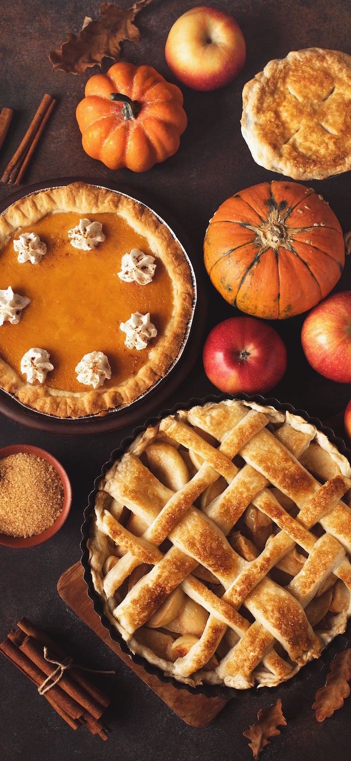 background thanksgiving wallpaper arranged table with pumpkins apple pie pumpkin pie apples cinnamon sticks on brown surface
