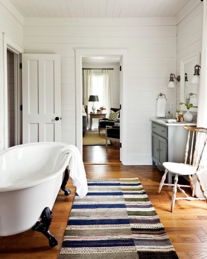 bath on wooden floor with carpet farmhouse bathroom decor wooden vanity with square mirror mounted on walls covered with white shiplap