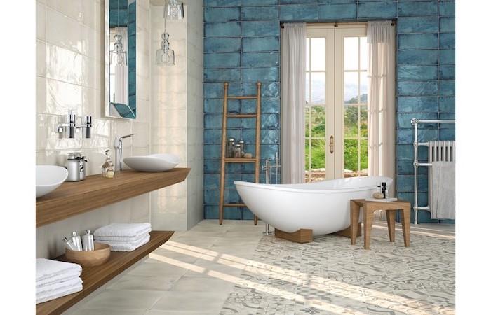 bathroom backsplash ideas blue tiles on the wall behind bathtub gray and white tiles on the floor with print