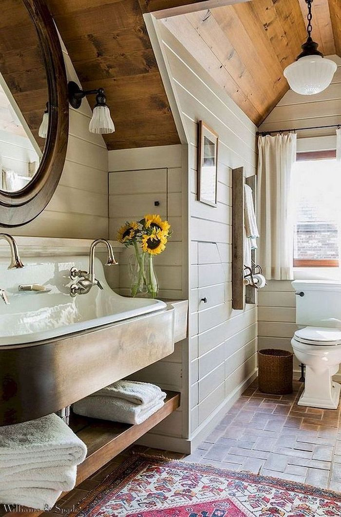bathroom decor signs vanity with open shelving tiled floor with small rug shiplap on the walls wooden ceiling