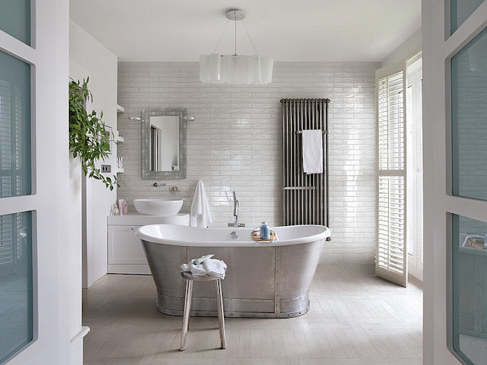 bathroom floor tile ideas white subway tiles accent wall wooden floor with metal bathtub in the middle industrial style