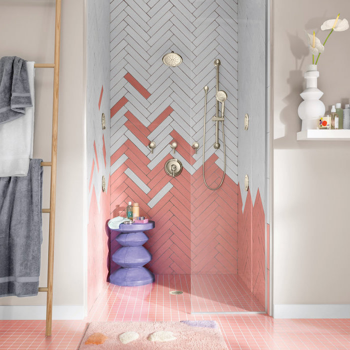 bathroom tile ideas for small bathrooms white and pink chevron tiles under the shower with gols shower heads pink square tiles on the floor