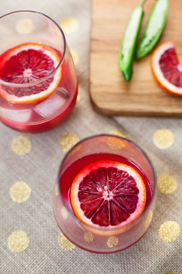 best cleanse for weight loss two glasses filled with red juice best cleanse for weight loss ice and orange slices inside the glasses