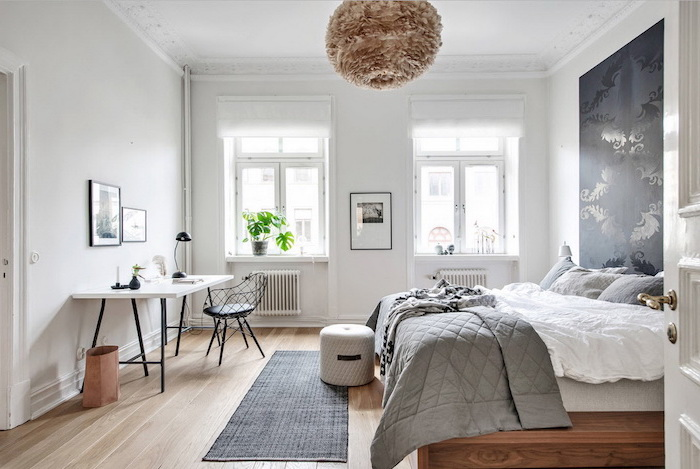 black accent on white wall above the bed scandinavian minimalism small black rug on wooden floor white desk table