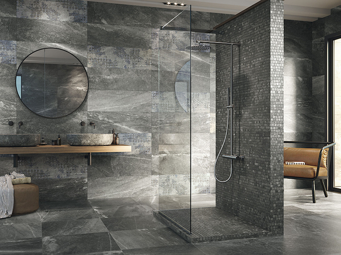 black and gray tiles on the walls and floor bathroom floor tile ideas black mosaic tiles on the shower wall and floor separated with glass