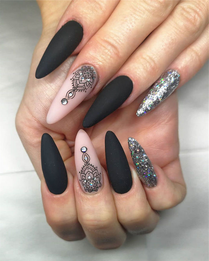 black and nude matte nail polish silver glitter on pinky fingers mandala decorations on middle fingers cute acrylic nails