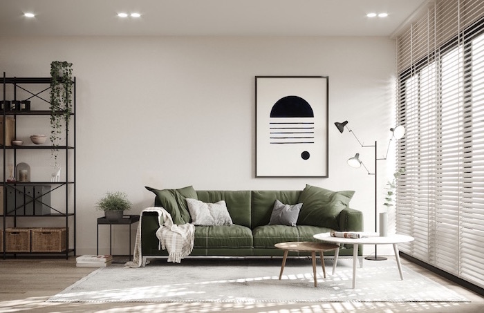 black open bookshelf olive green sofa scandinavian living room two round coffee tables white carpet on wooden floor