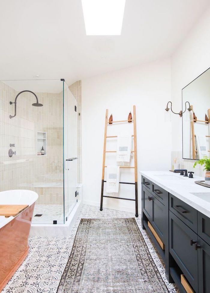 black vanity with two sinks white countertop modern farmhouse bathroom vanity printed tiles on the floor with rug shower cabin