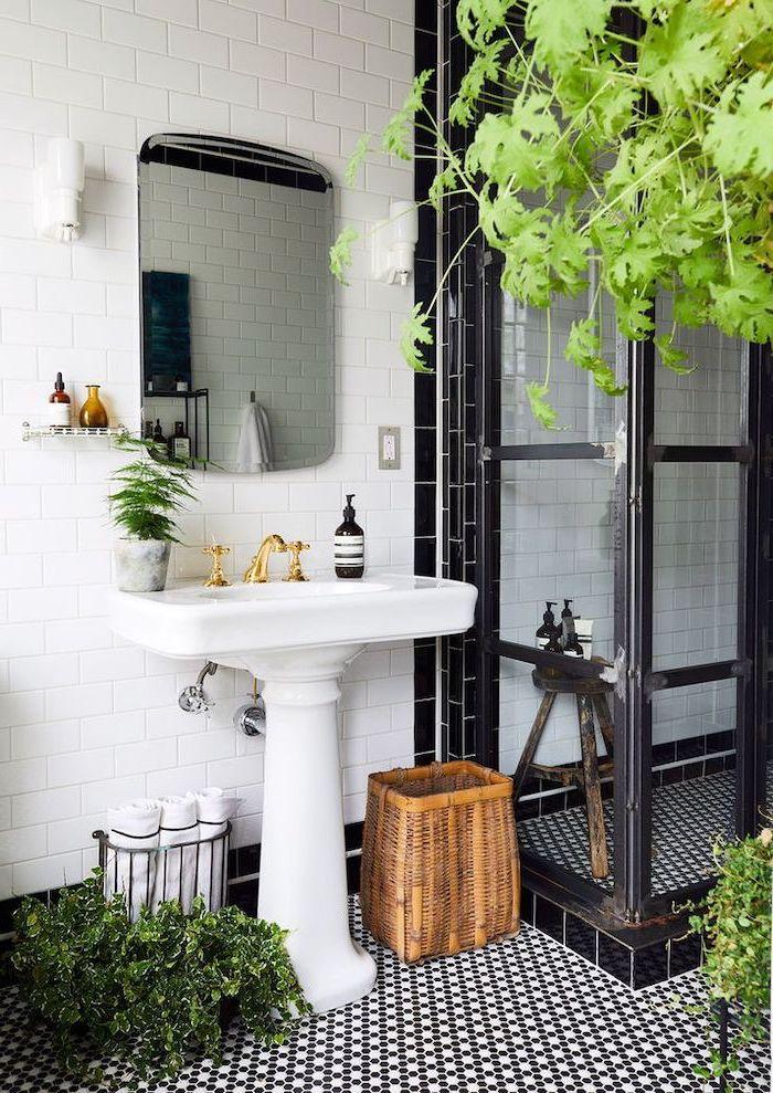 black white mosaic tiles on the floor modern farmhouse bathroom white subway tiles on the walls glass shower separator with black frames