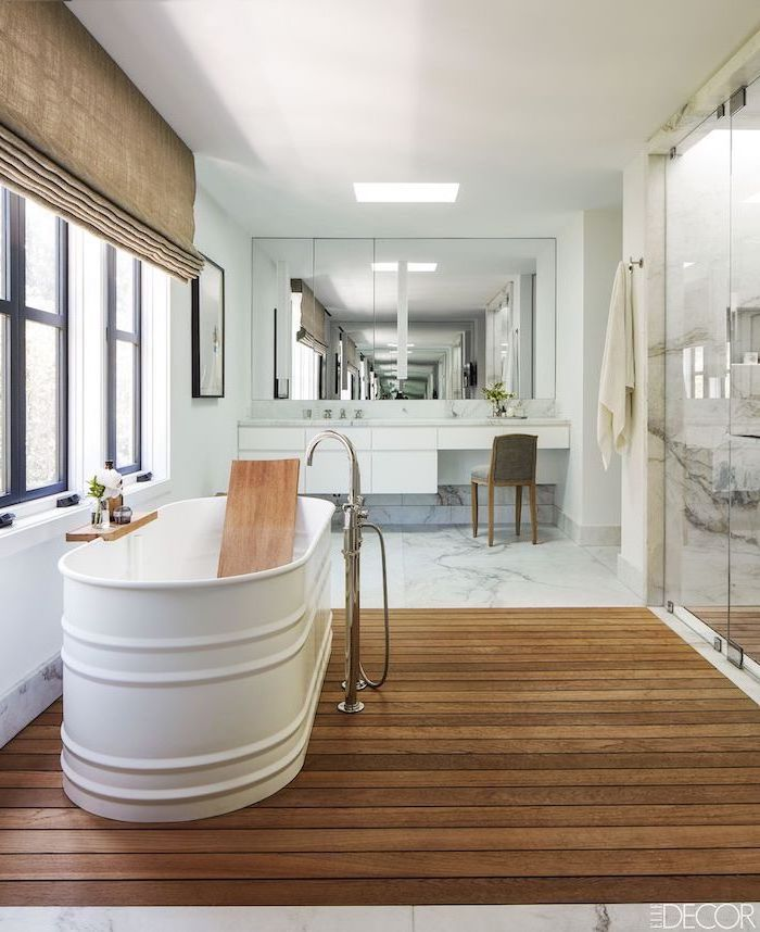 black window frames next to bath farmhouse bathroom wall decor wooden floor under the bath marble floor under white floating vanity