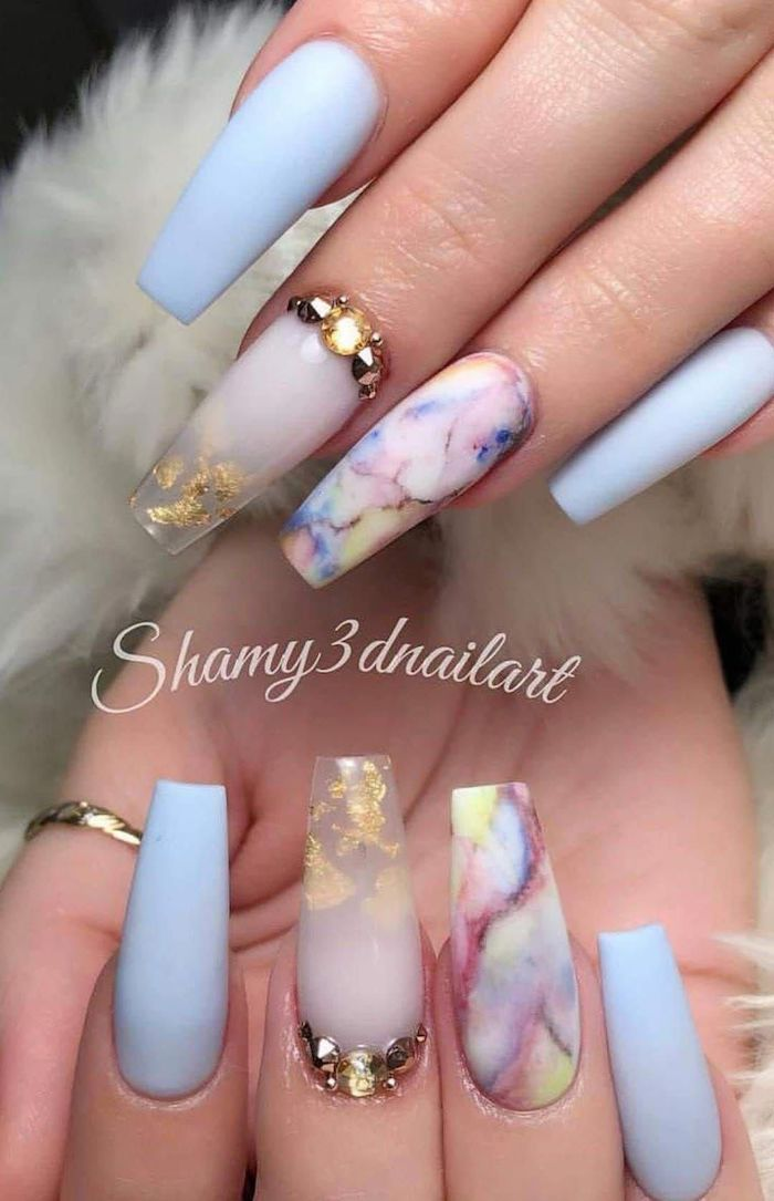 blue matte nail polish acrylic nail ideas decorations with gold leaves rhinestones on middle fingers colorful marble on ring fingers